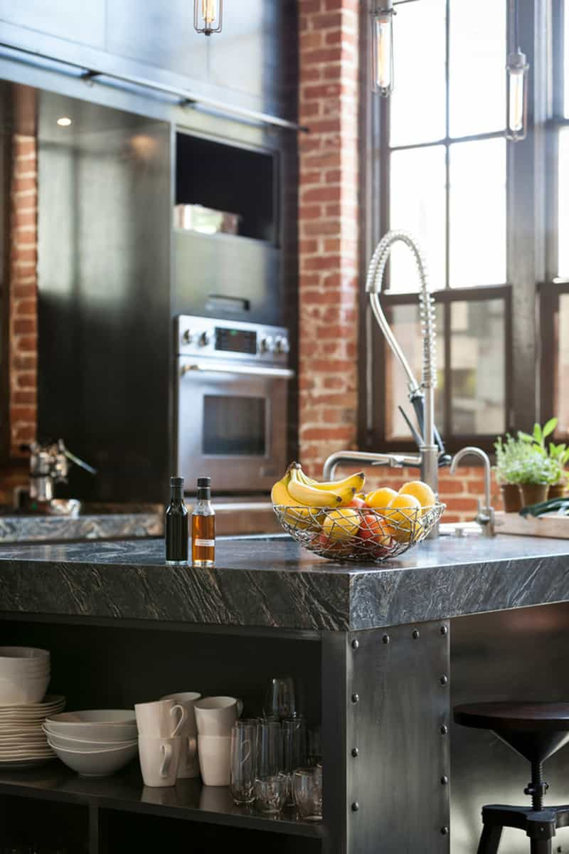 The ever-present industrial style kitchen faucet with pull down. What would  an industrial kitchen be without one? Clocktower loft, San Franciso, ...