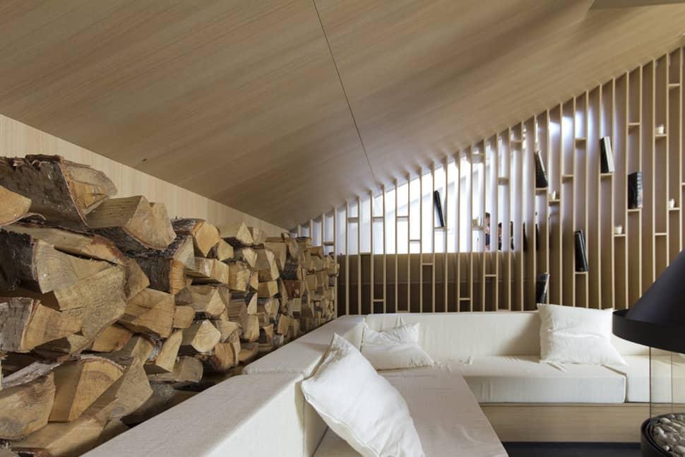 mansard den with bonfire inspired fireplace 6