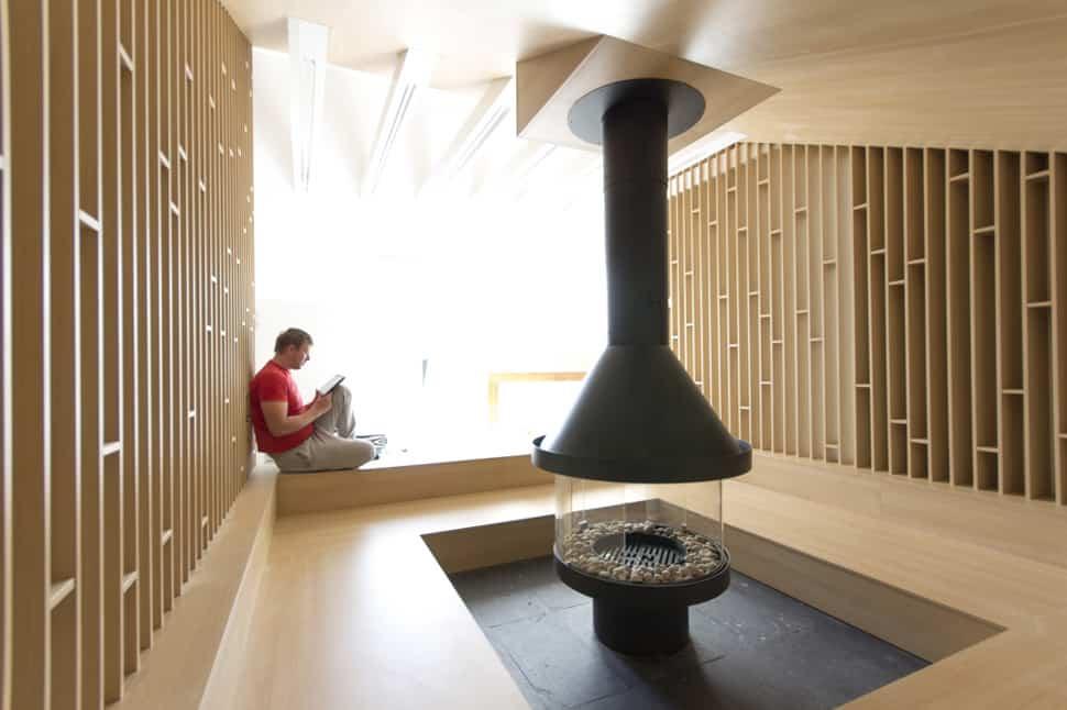 mansard den with bonfire inspired fireplace 8
