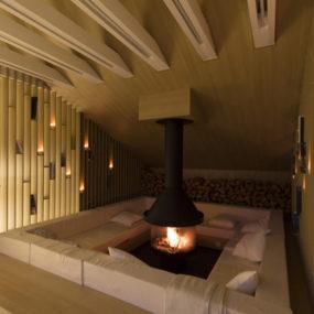 Mansard Den with Bonfire-inspired Fireplace