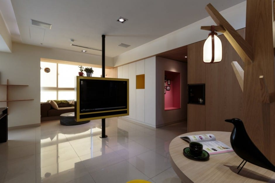 View In Gallery Pivoting Tv Turns Playful Apartment Into Entertainment Area