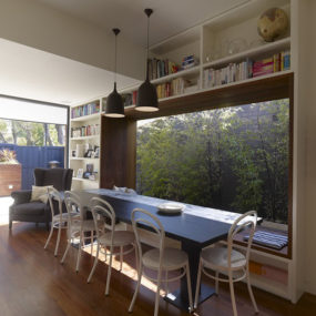 Small modern home outfitted with the coolest window seat