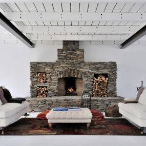 White Swedish Interiors with Fireplace Features