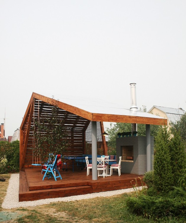 modern-outdoor-pavilion-with-fireplace-and-ping-pong-table-5.jpg