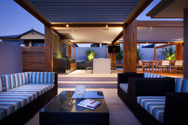massively-modern-timber-terraces-extend-australian-home-outward-4-couches-kitchen.jpg