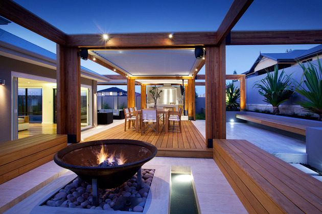 massively-modern-timber-terraces-extend-australian-home-outward-8-fire-dining.jpg