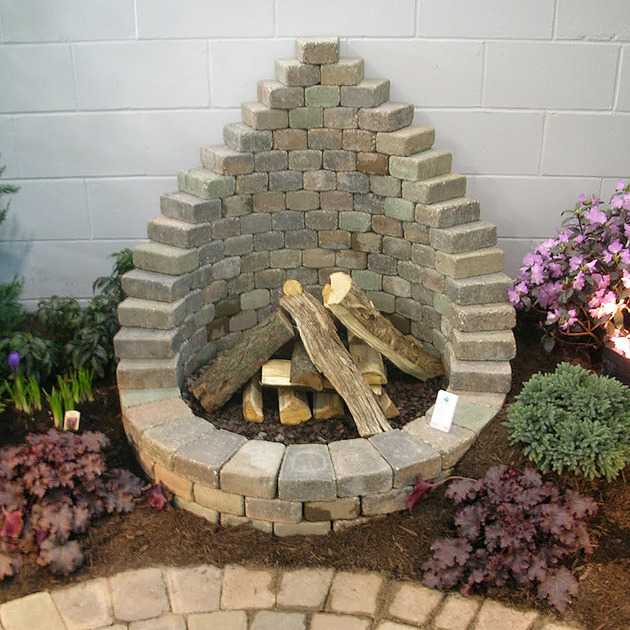 tear drop fire pit thumb 630xauto 53439 How to Be Creative with Stone Fire Pit Designs: Backyard DIY