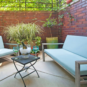 Cozy Outdoor Space Featuring Stainless Furniture by Modernica