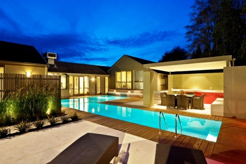 5 modern lap pool design ideas by out from the blue for Swimming pool entertaining areas