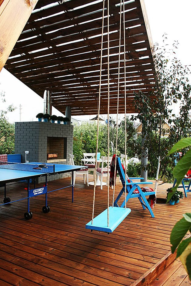Modern Outdoor Pavilion With Fireplace And Ping Pong Table
