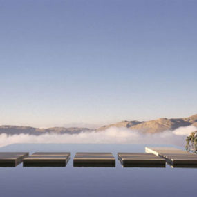 Negative Edge Swimming Pool Overlooking the Mountains