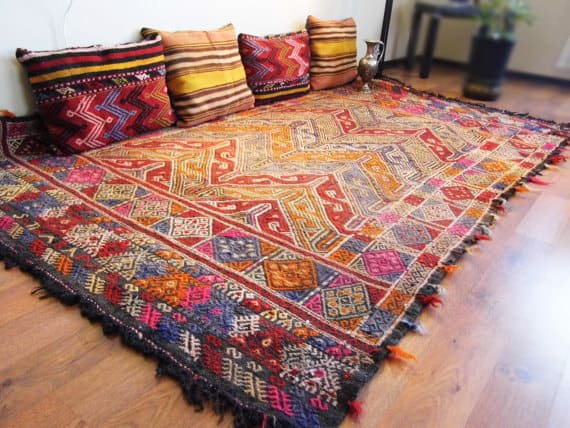 turkish-anatolian-kilim-rug-with-accent-pillows.jpg