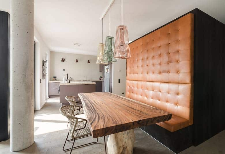 built in dining nook with rustic table and leather sitting