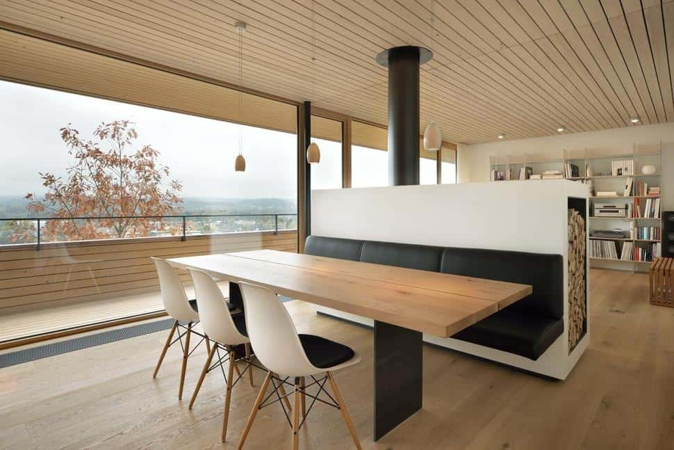 This Next Dining Nook Serves As A Room Divider From The Living Room And Has  A Black Leather Dining Bench, A Wood Stove And A Wood Storage, All Built  Into A ...