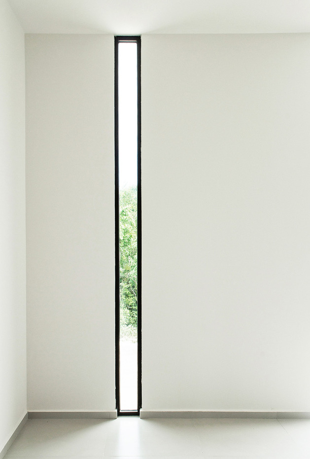 unusual-home-design-narrow-window.jpg