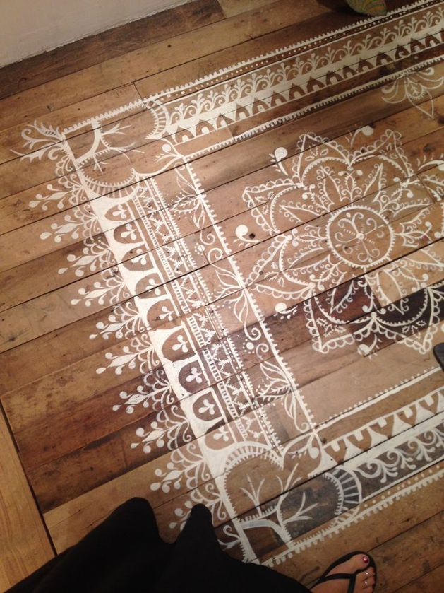 natural-wood-floor-white-faux-rug.jpg