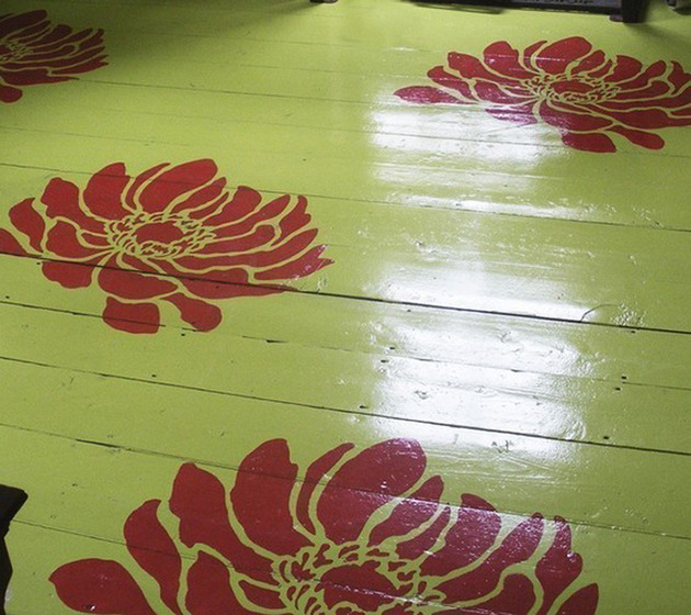 oversized-burgundy-flower-stencils-on-green-floor.jpg