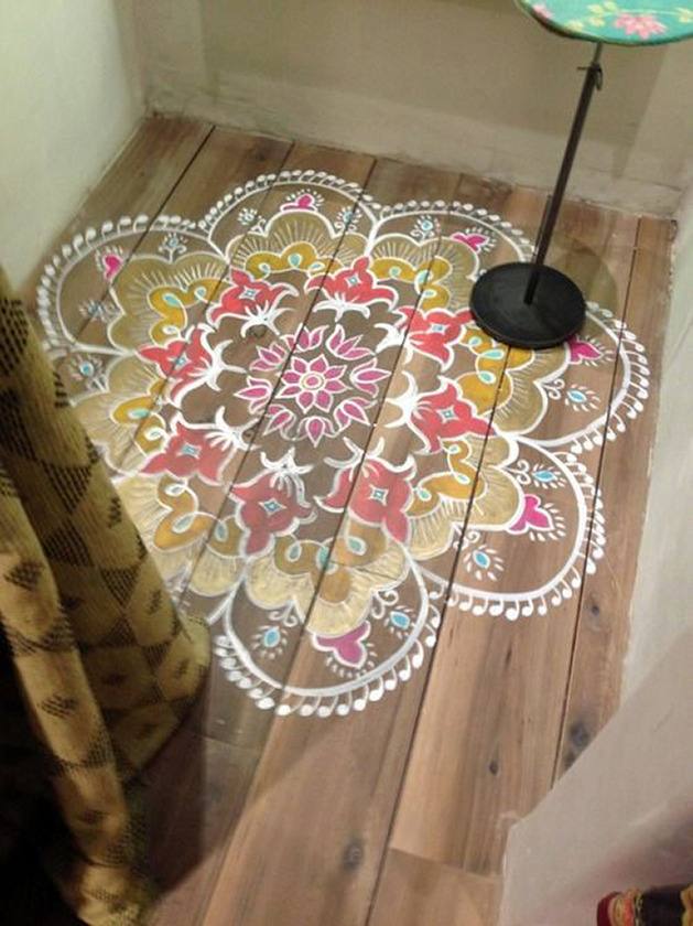 small-color-rug-painted-on-wide-plank-floor.jpg