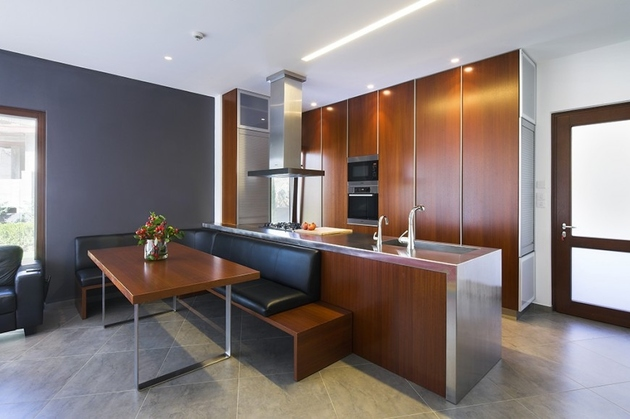 large-corner-kitchen-island-breakfast-nook-with-modern-bench.jpg